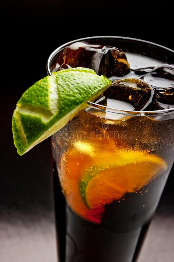 Cold tea with lime and ice royalty free stock photos