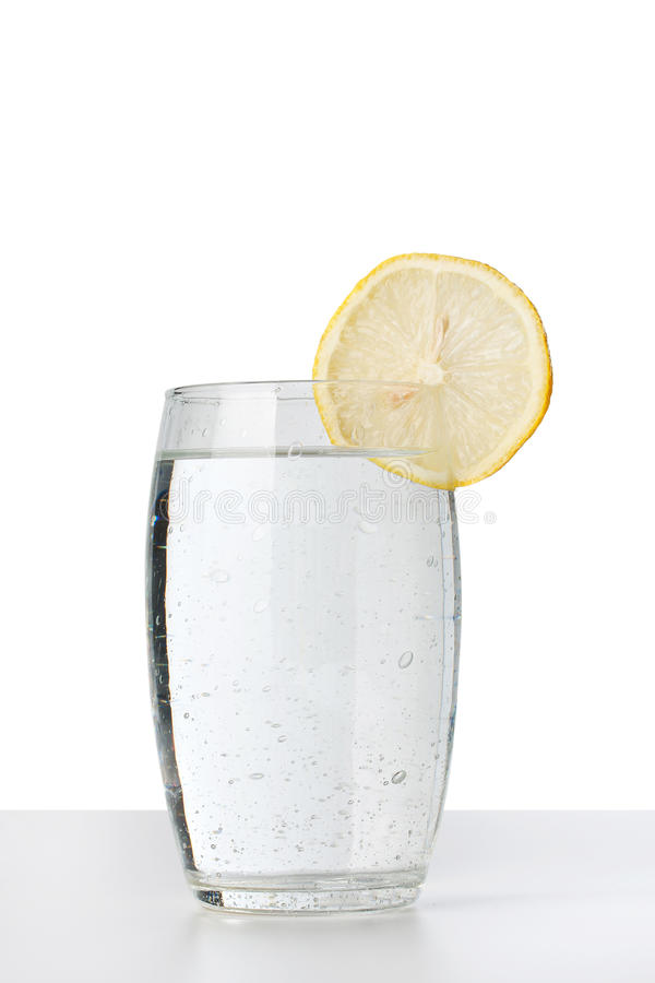 Cold water glass. With lemon royalty free stock images
