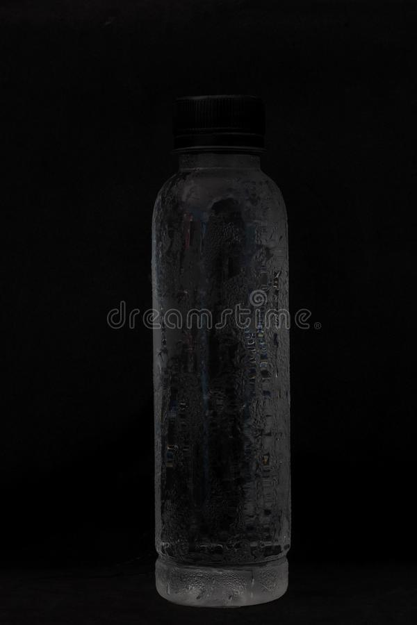 Cold water in plastic bottles Helps quench thirst. Cold water in plastic bottles Helps quench thirst in the summer royalty free stock photos