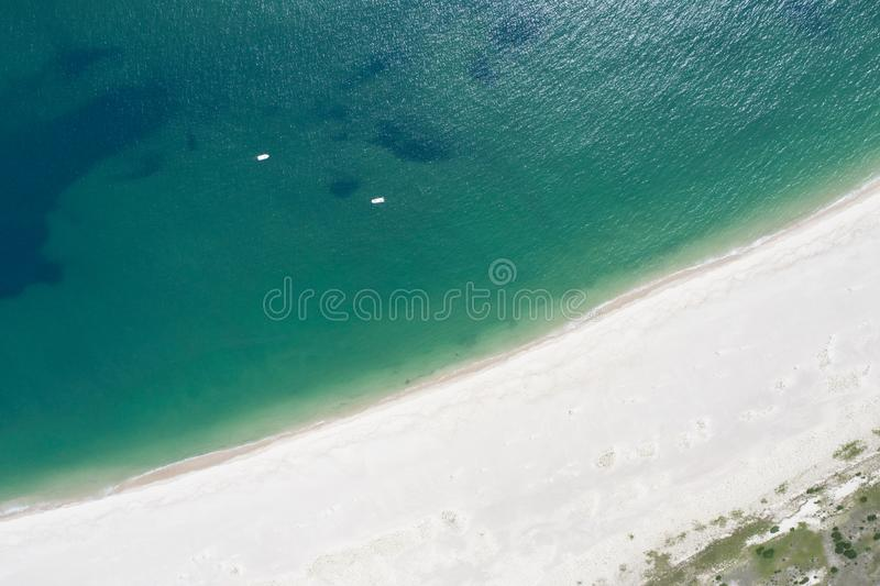 Aerial of Atlantic Ocean and Beach on Cape Cod, Massachusetts. The cold waters of the Atlantic Ocean bathe a scenic beach on Cape Cod, Massachusetts. This royalty free stock image