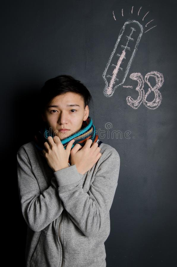 Winter. Colds and a young man. Cold weather. Colds and health problems royalty free stock image
