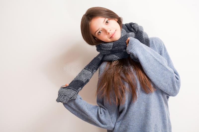 Cold weather coming. Cold weather coming, cute brunette girl in scarf and sweater royalty free stock photos