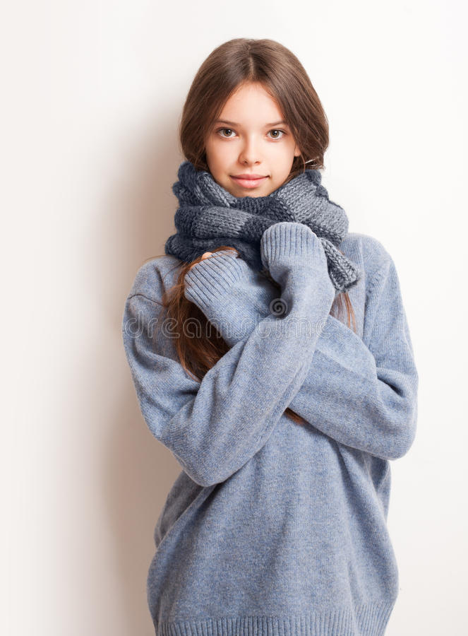 Cold weather coming. Cold weather coming, cute brunette girl in scarf and sweater stock photo