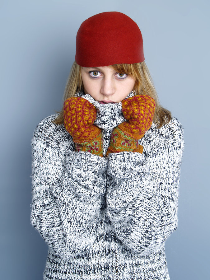Cold winter. Woman with glove and hat scared from winter stock photo