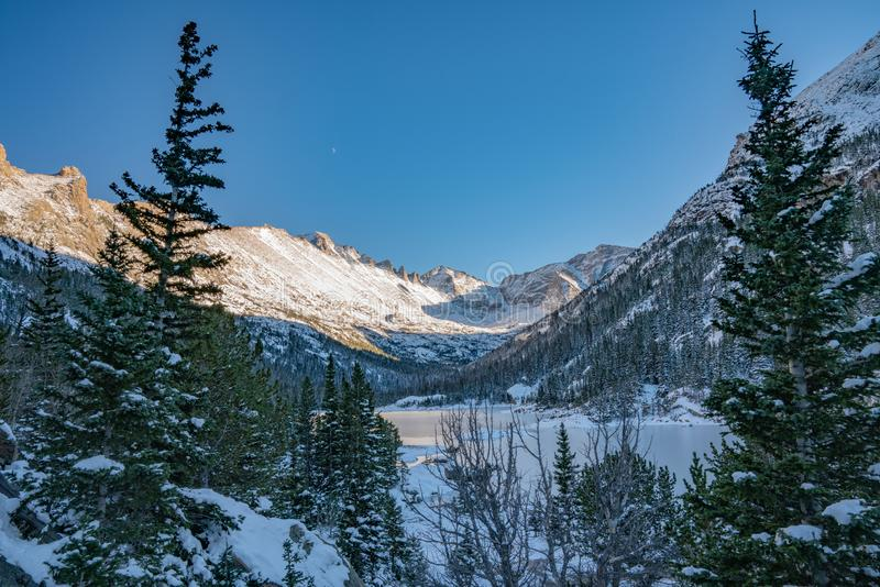 Cold Winter Day in Rocky Mountain National Park. Cold winter day hiking in Rocky Mountain National Park. Frozen lake beneath `The Spearhead` a famous climbing stock photo