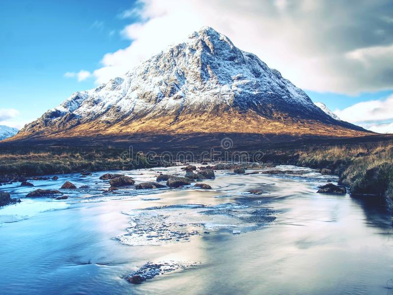 Cold winter day on meadow at river Coupall at delta to river Etive. Near Glencoe in the Scottish highlands stock image