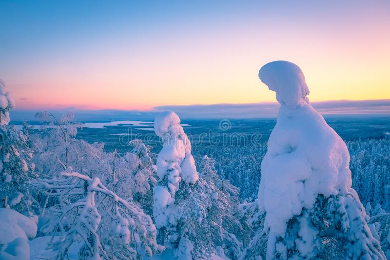 Cold winter day sunset view. Photo from Sotkamo, Finland. stock photos