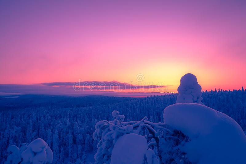 Cold winter day sunset view. Photo from Sotkamo, Finland. royalty free stock images