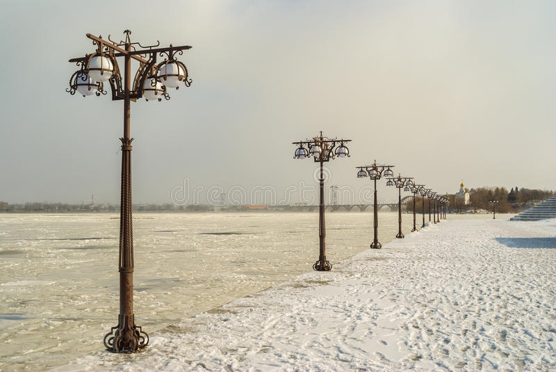 Cold winter on a frozen river Dnepr embankment. In Denpropetrovsk city, Ukraine stock photo