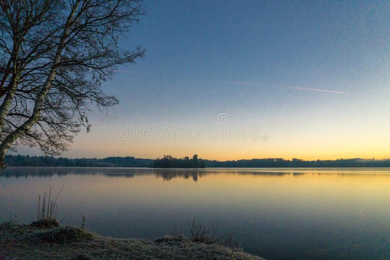 Cold winter morning at lake Riegsee royalty free stock photography