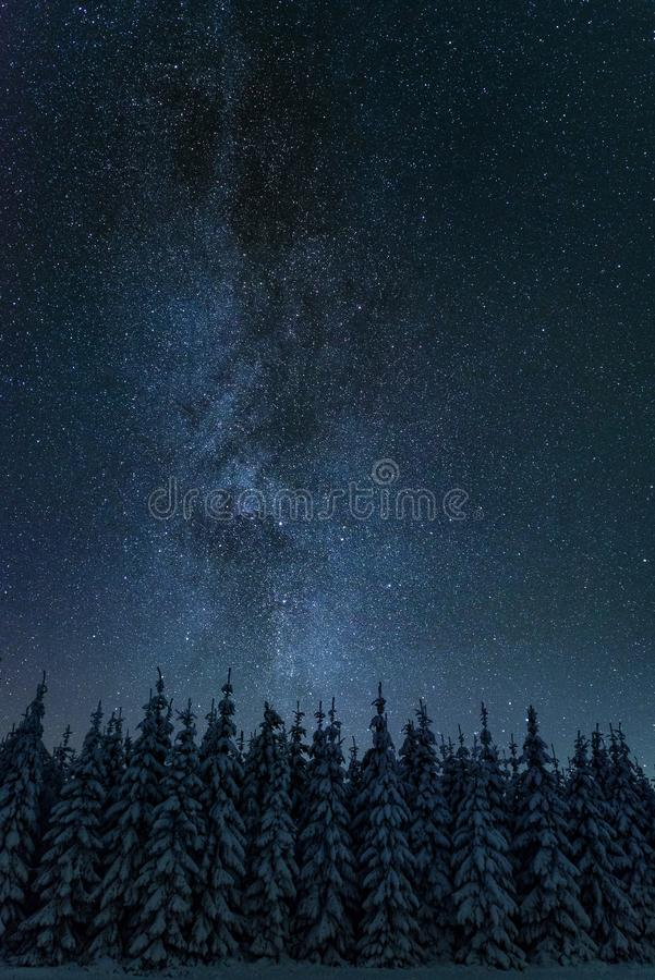 Milky way in cold winter night landscape royalty free stock photography
