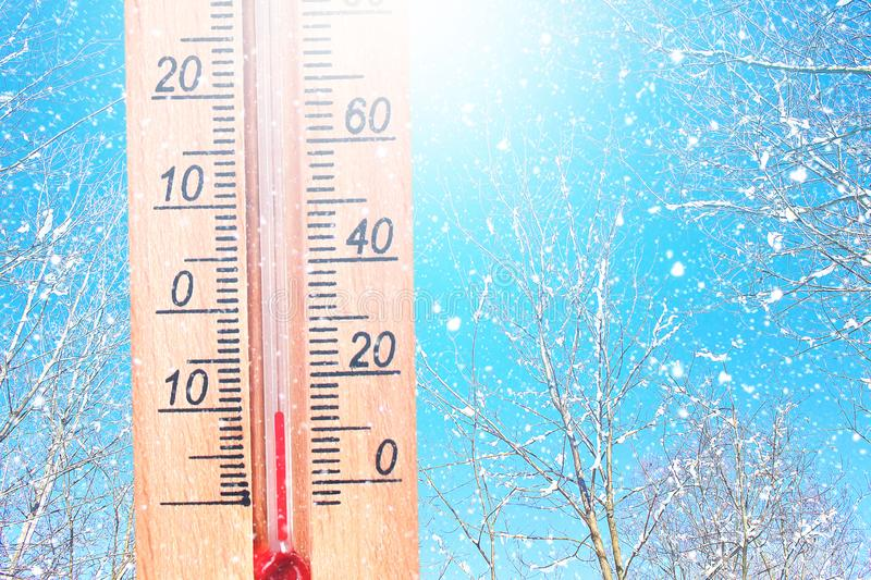 Cold winter weather - 10 degrees Celsius. Thermometer in winter frosty weather in the snow shows low temperatures - minus ten. Low royalty free stock photo