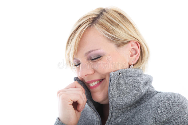 Download Cold Woman Cuddling Into Her Jacket Stock Photo - Image: 26027760