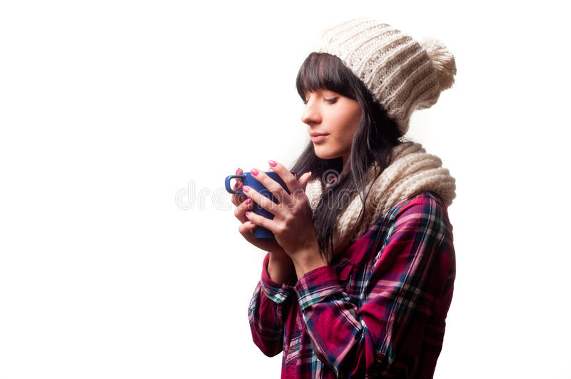 A cold woman. Drinking a hot drink stock photo