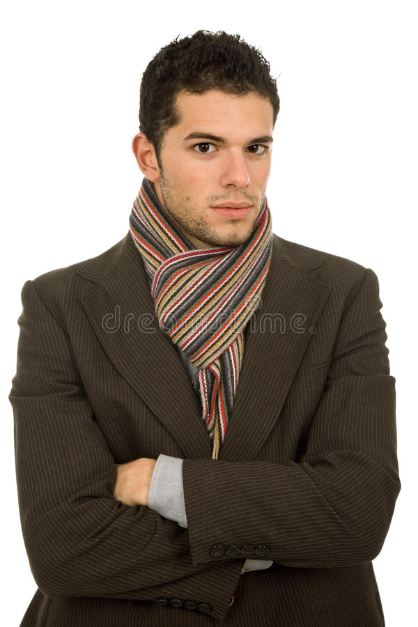 Cold. Young man portrait, dressed for winter, in white stock images