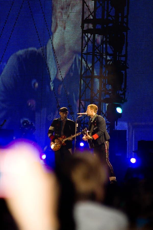 Coldplay en concierto foto de archivo