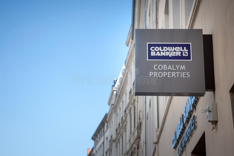 Coldwell Banker logo in front of their real estate agent for Lyon. Coldwell Banker is an American real estate franchise royalty free stock image