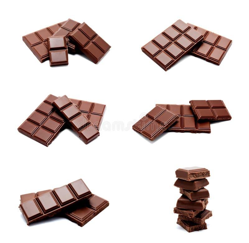 Coleção da pilha escura das barras de chocolate do leite das fotos isolada imagem de stock royalty free