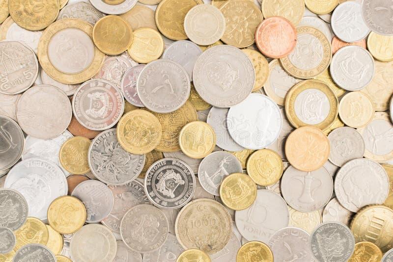 Coleção das moedas de todo o mundo imagens de stock royalty free