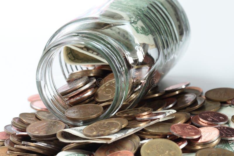 Coleção das moedas em um frasco foto de stock royalty free
