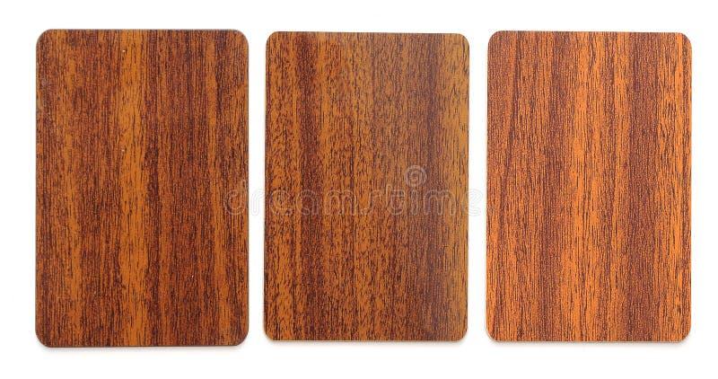 Coleção de espaços em branco plásticos de madeira do cartão fotos de stock royalty free