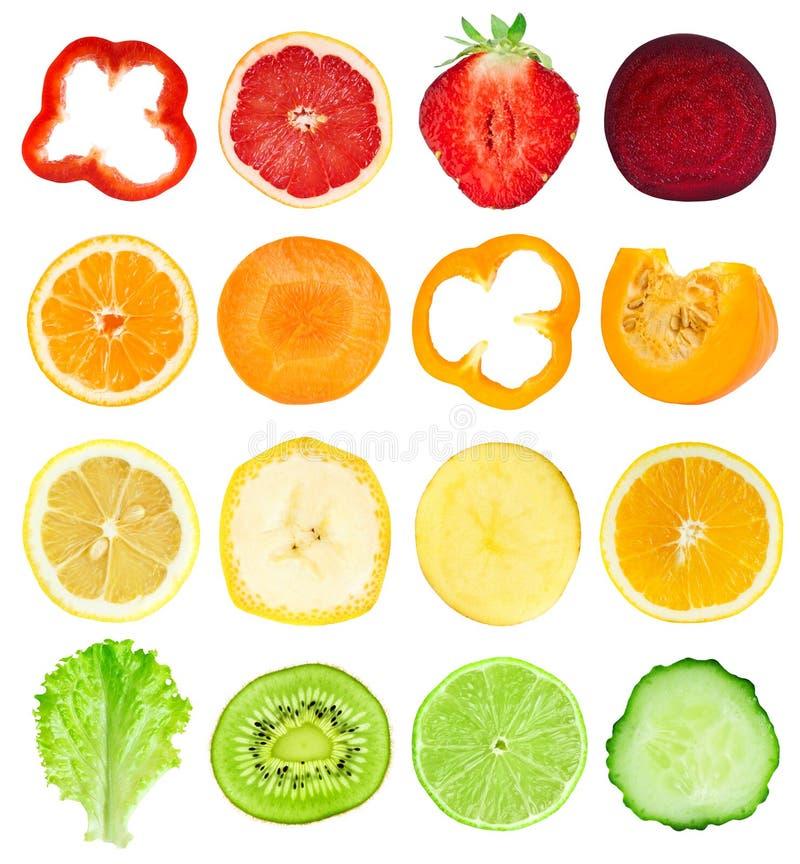 Coleção de fatias frescas das frutas e legumes fotos de stock