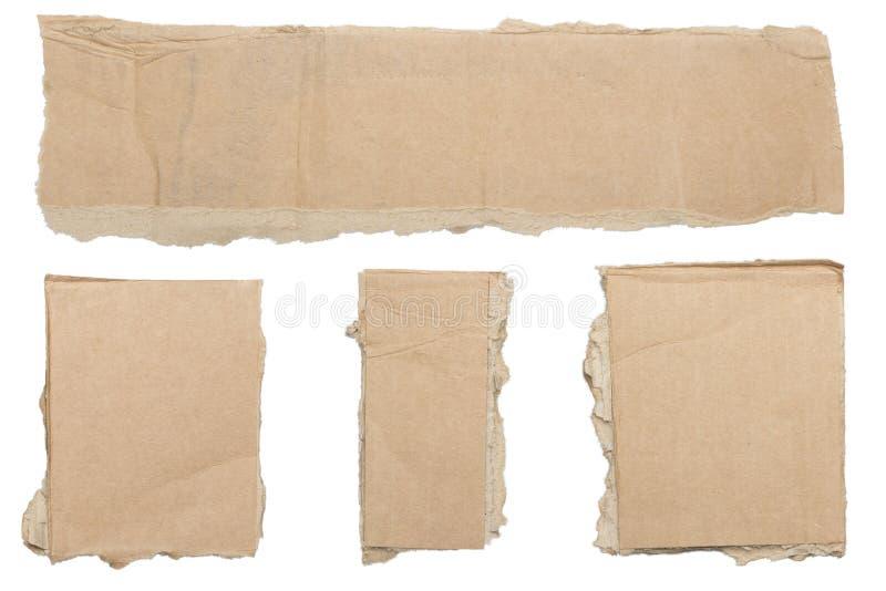 Coleção de partes marrons rasgadas de cartão imagem de stock