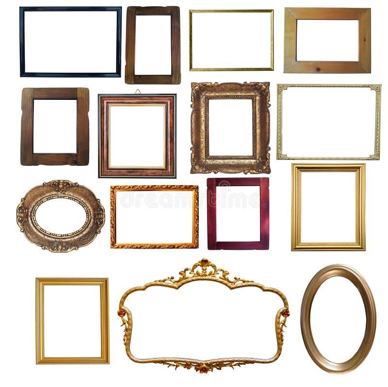 Coleção do vintage de madeira e dos quadros vazios dourados isolados sobre fotografia de stock