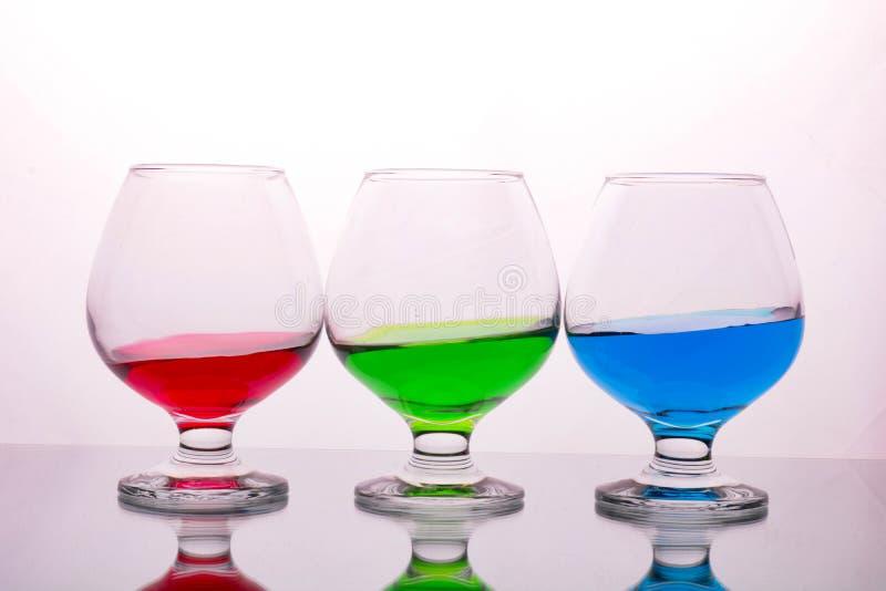 Coleção dos vidros com bebidas coloridas fotos de stock royalty free