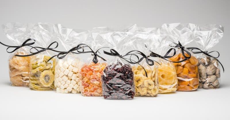 Coleção secada orgânica dos frutos no plástico transparente luxuoso fotografia de stock royalty free