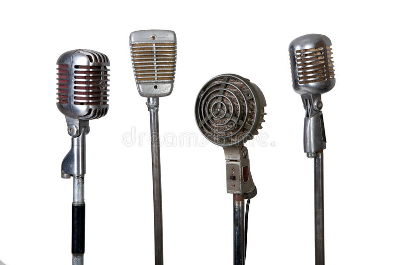 Coleção velha do microfone fotografia de stock