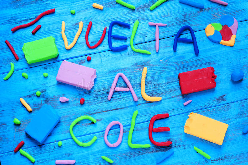Cole do al de Vuelta, de volta à escola escrita no espanhol imagem de stock royalty free