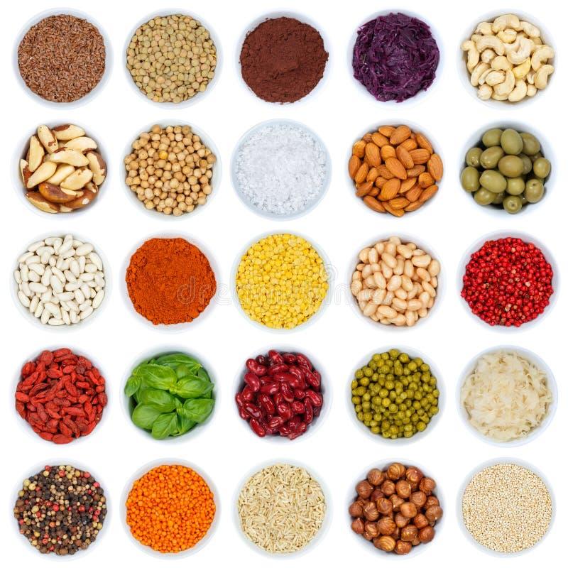 Colección de especias y de cuadrado nuts de las verduras de las hierbas desde arriba imágenes de archivo libres de regalías
