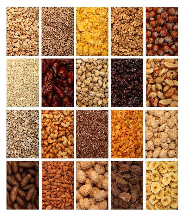 Colección de frutas, de cereales, de semillas sanas y de nueces secados aislados en el fondo blanco imagenes de archivo