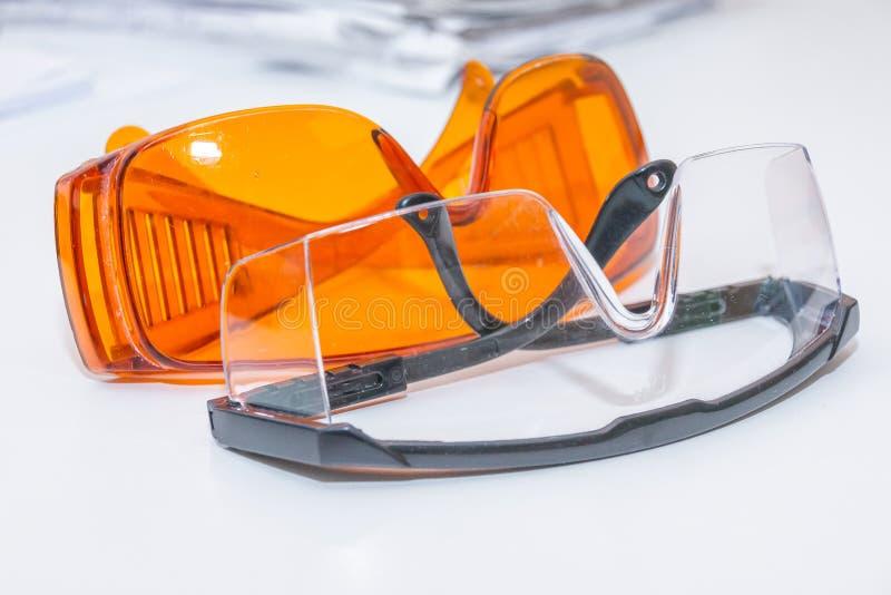 Colección de gafas de seguridad para el paciente otro, equipo de la salud para prevenir la infección cruzada Dentista Clinic prot imágenes de archivo libres de regalías
