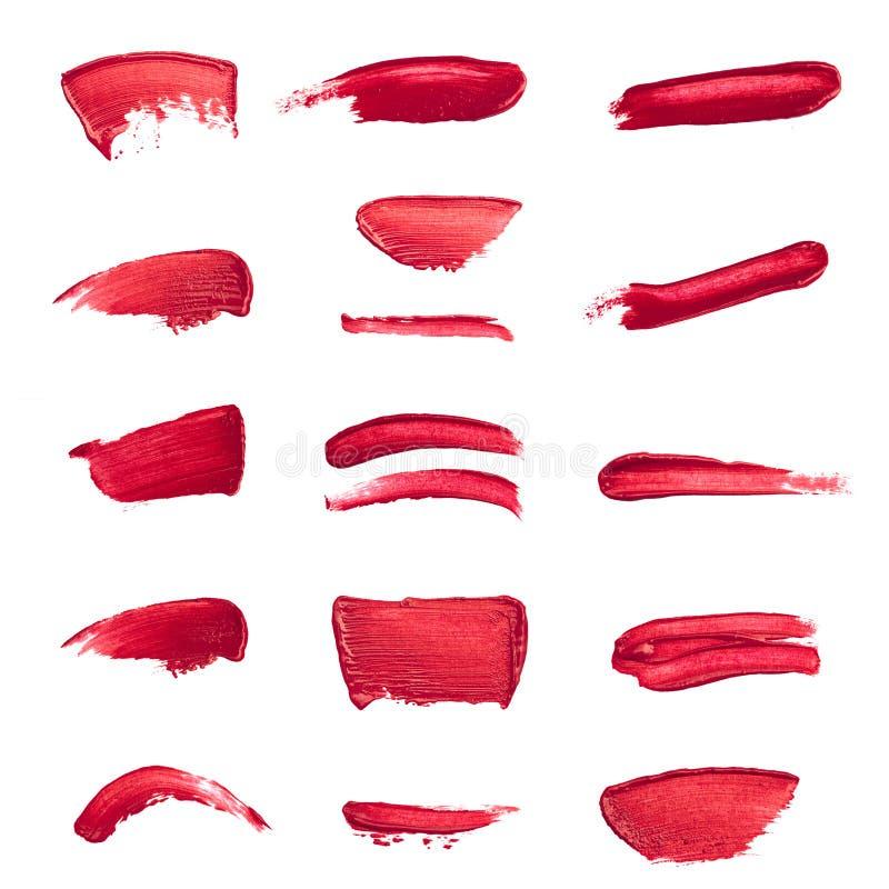Colección de lápices labiales manchados aislados en blanco fotografía de archivo