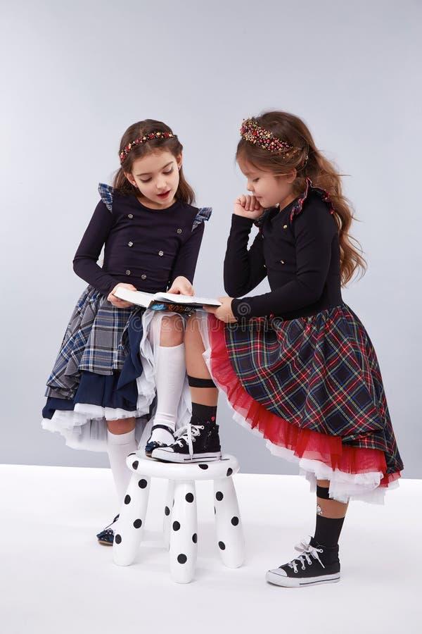 Colección de la ropa de la muchacha del vestido pequeña linda fotografía de archivo libre de regalías