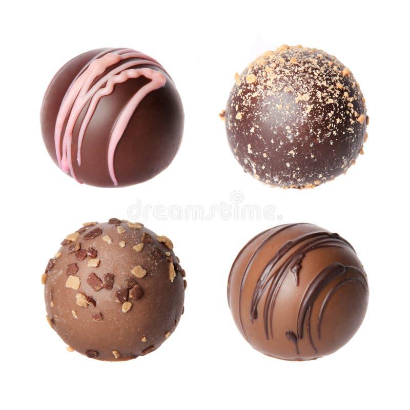 Colección de los caramelos de chocolate. Trufas belgas hermosas aisladas fotografía de archivo libre de regalías