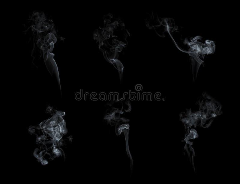 Colección del humo aislada en fondo negro fotografía de archivo libre de regalías