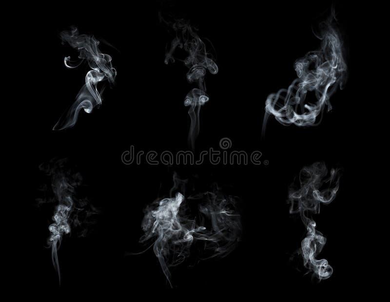 Colección del humo aislada en fondo negro foto de archivo