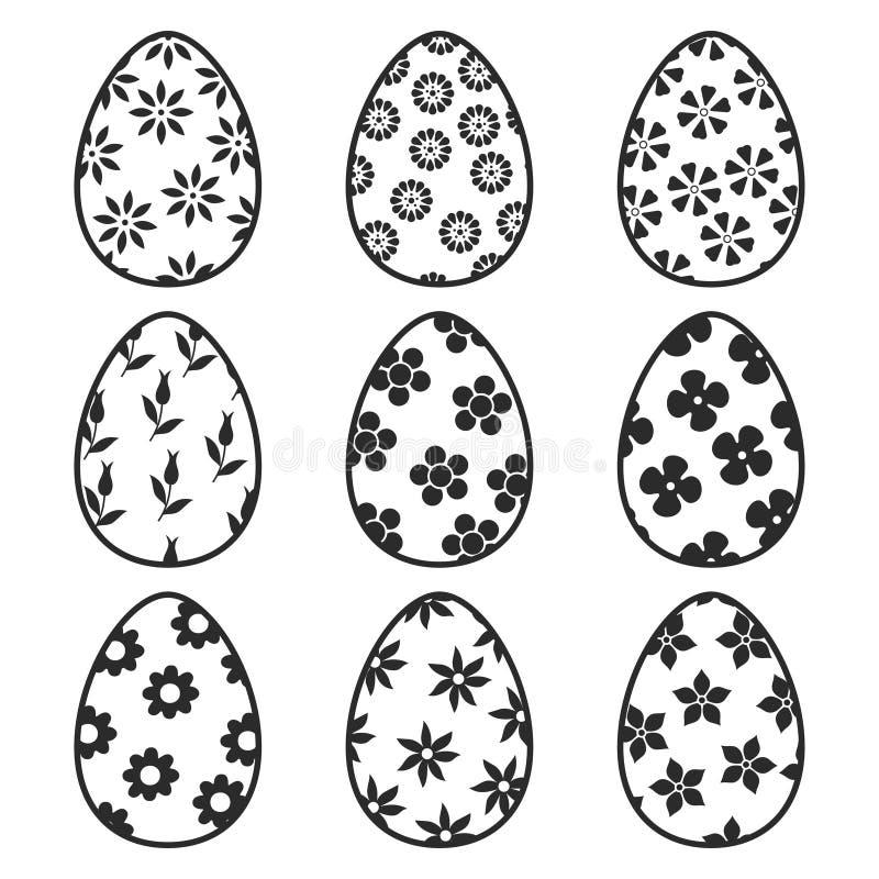 Colección del icono de los huevos de Pascua Fije de los huevos de Pascua monocromáticos con la decoración floral Aislado en los h libre illustration