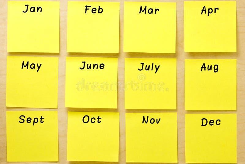 Colección en blanco del post-it del amarillo del calendario fotos de archivo