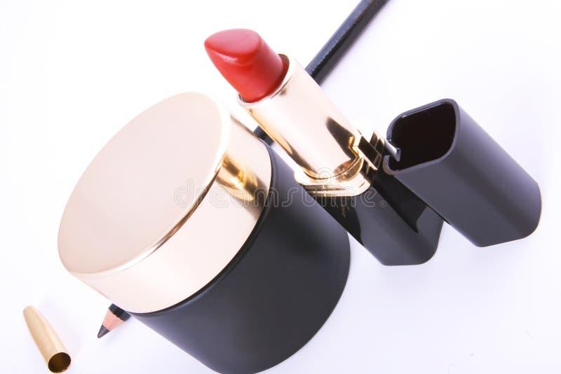 Colección negra de los cosméticos en blanco imagen de archivo