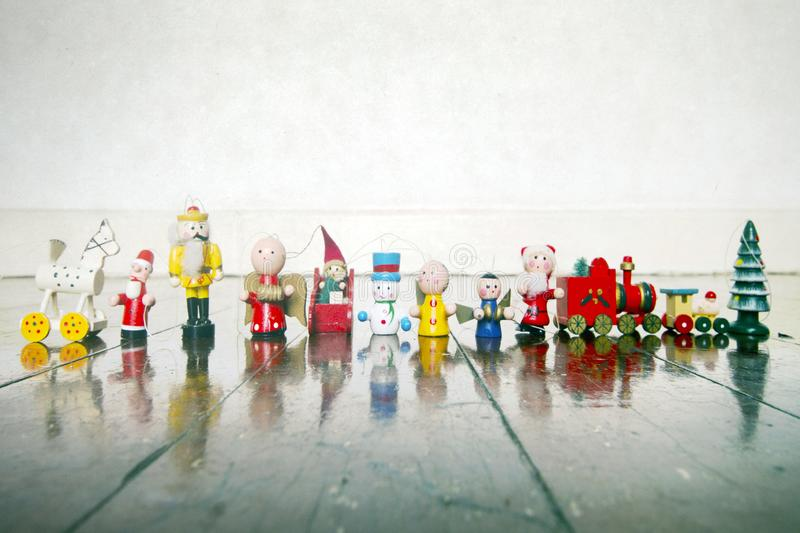 A colection of old wooden Chrismas decorations. On a wooden floor stock image