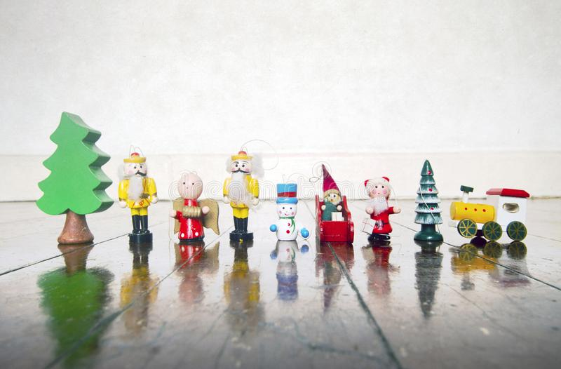A colection of old wooden Chrismas decorations. On a wooden floor royalty free stock images