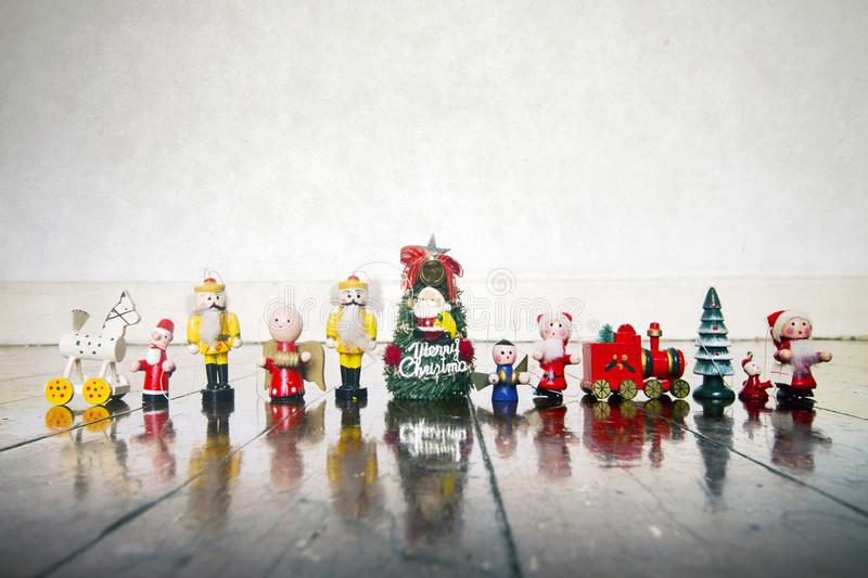 A colection of old wooden Chrismas decorations. On a wooden floor stock photo