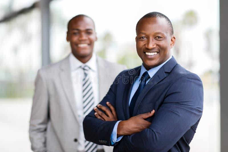 Colega africano del hombre de negocios imagen de archivo