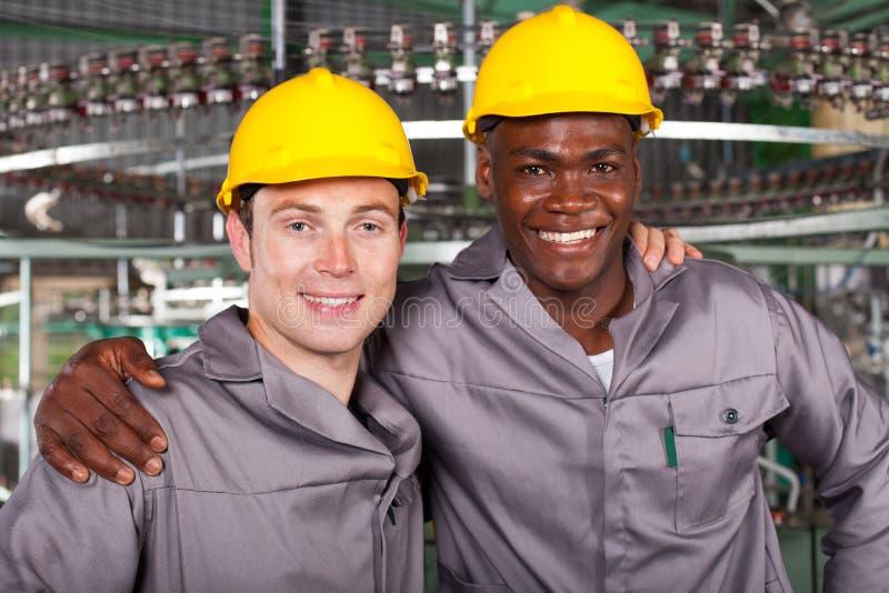 Colegas de los trabajadores industriales foto de archivo libre de regalías