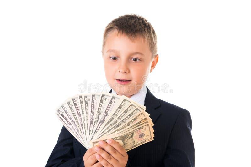Colegial emprendedor joven del muchacho en un traje de negocios que sostiene el dinero en sus manos Cómo ganar primeros millón de imagenes de archivo
