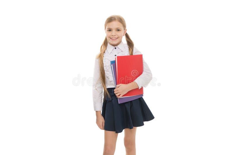 Colegiala lista para estudiar Estudio en escuela Hora de estudiar Fondo blanco del libro del control de la muchacha Concepto de l imagen de archivo